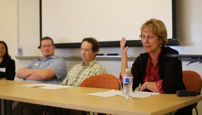Carol Genetti talks at the reunion panel