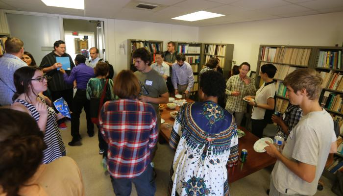 Graduate students and faculty enjoying snacks