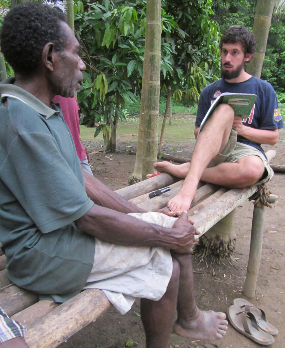 Graduate student Don Daniels working with a consultant in Papua New Guinea.