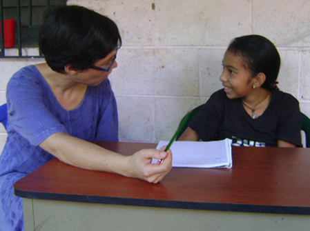 Graduate student Lynnette Arnold working with a student in El Salvador