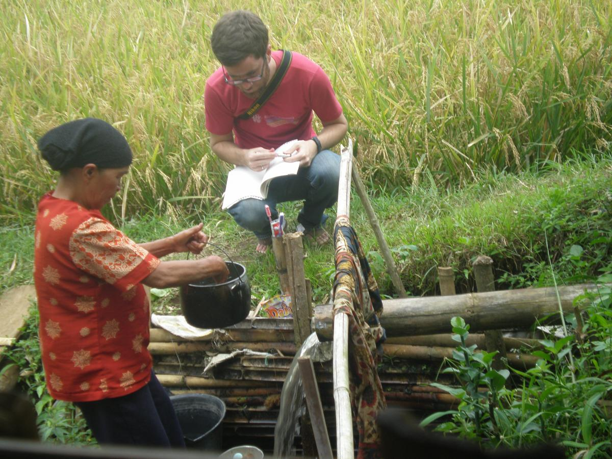 Graduate student Brad McDonnell working with a consultant in Indonesia